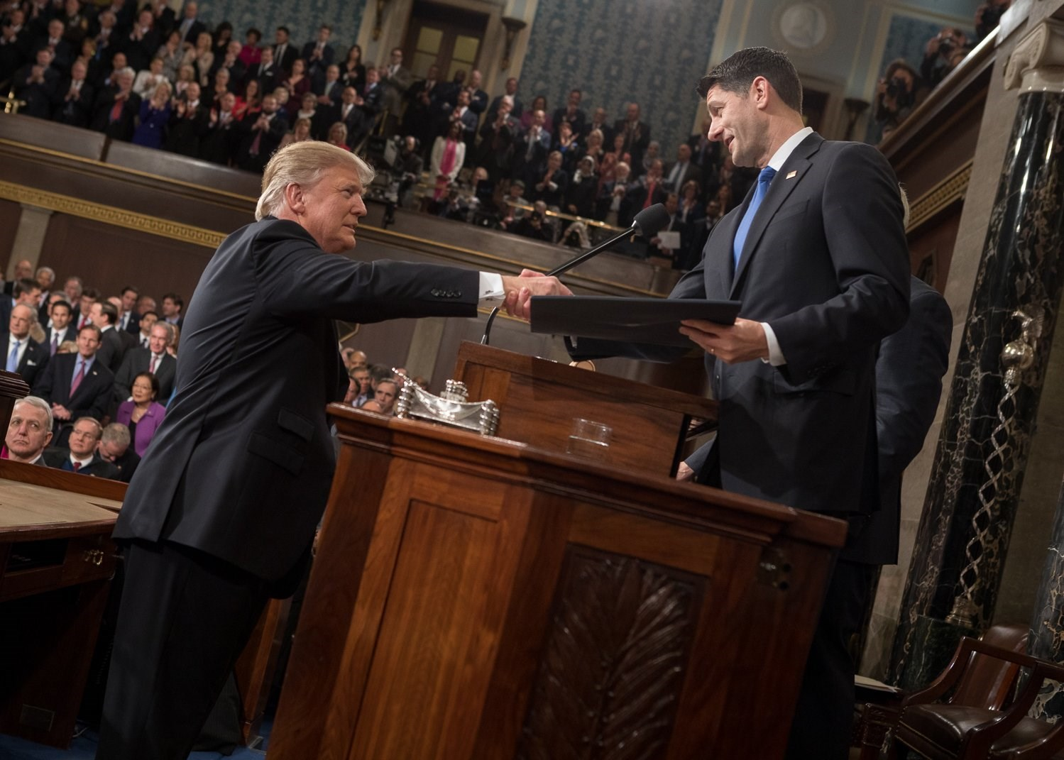 """By Office of the Speaker (https://twitter.com/SpeakerRyan) [Public domain], <a href=""""https://commons.wikimedia.org/wiki/File%3ATrump_shaking_hands_with_Paul_Ryan.jpg"""">via Wikimedia Commons</a>"""